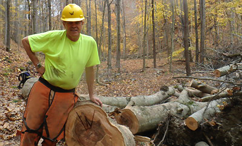 Phil Wlicoxson of Hoosier Hikers Council cuts most of the logs along the Tecumseh Trail.  He often leaves a W as his calling card.